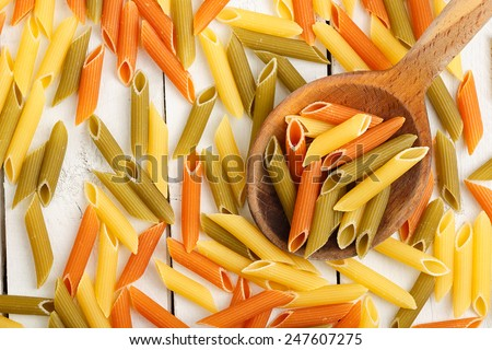 penne pasta on white wooden table  - stock photo