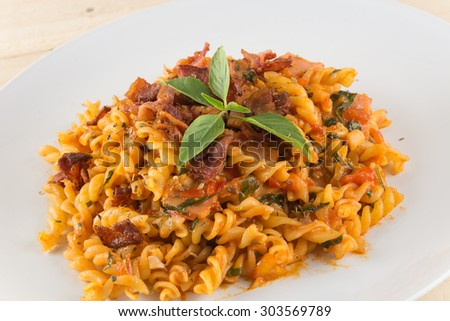 penne pasta on wood background