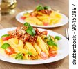 Penne pasta with a bolognese tomato beef sauce - stock photo