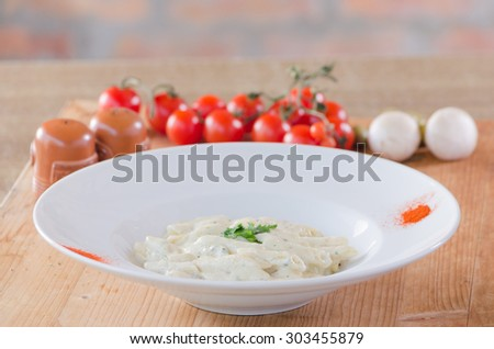 Penne pasta with a white creamy sauce