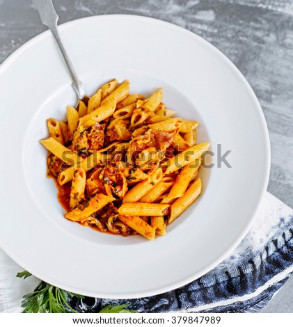 Penne pasta with bacon - stock photo