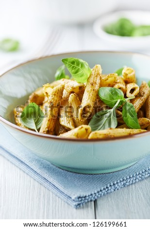 Penne pasta with basil pesto - stock photo