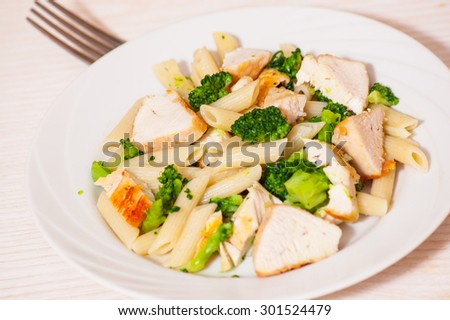 penne pasta with chicken and broccoli - stock photo