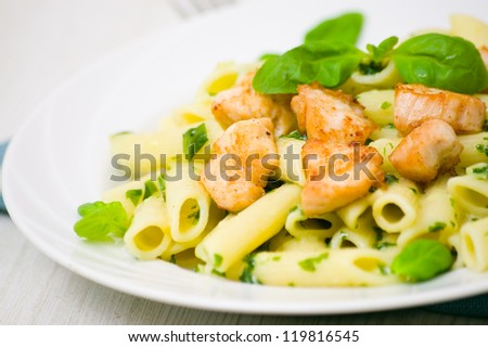 penne pasta with chicken breast and pesto sauce - stock photo