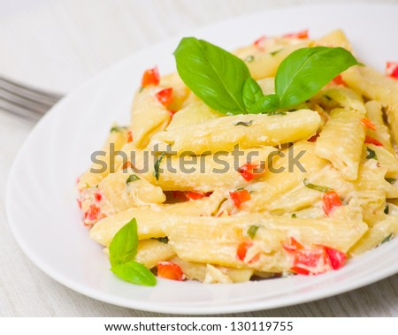 Penne pasta with cream sauce, paprika