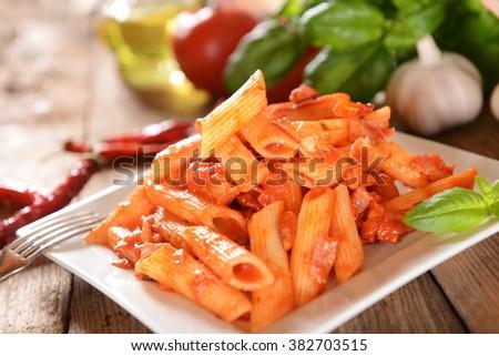 Penne pasta with hot chili sauce arrabiata - stock photo