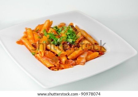 Penne pasta with reach tomato sauce - stock photo
