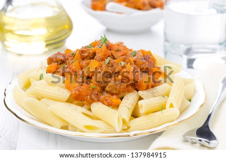 penne pasta with sauce of beef, tomato and pumpkin on the plate