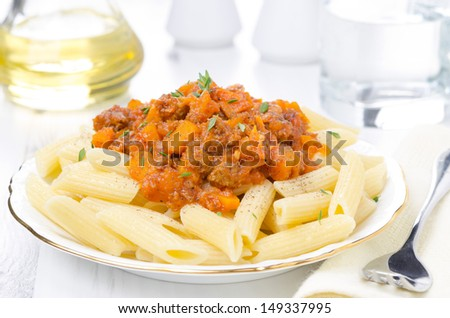 penne pasta with sauce of beef, tomato and pumpkin on the plate horizontal