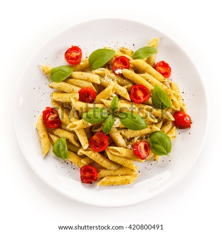 Penne, pesto sauce and vegetables  - stock photo