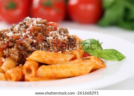 Penne Rigate Bolognese or Bolognaise sauce noodles pasta meal on a plate - stock photo