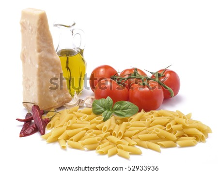 Penne with ingredients of spicy tomato sauce - stock photo