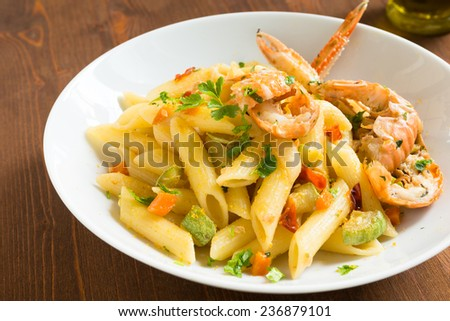 Penne with lobsters, zucchini, carrot and bottarga, Sardinian Cuisine  - stock photo