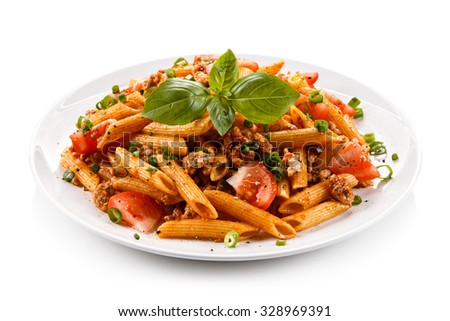 Penne with meat, tomato sauce and vegetables - stock photo