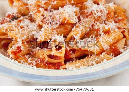 Penne with sauce and cheese