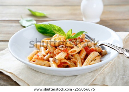 penne with sauce and mushrooms, food closeup - stock photo