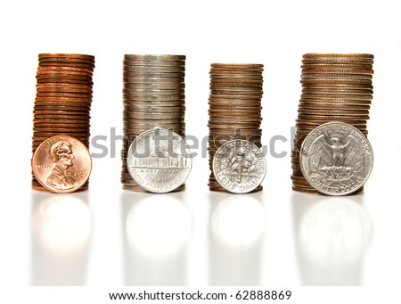 Pennies, nickels, dimes and quarters neatly stacked together isolated on white. - stock photo