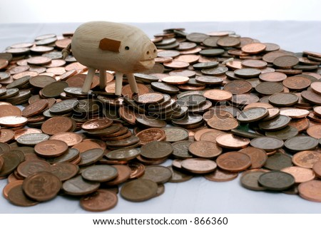 pennies with pig - stock photo
