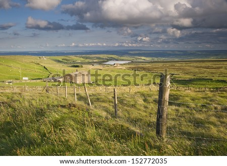 Pennine farm on windswept moorland above calderdale in the yorkshire dales. - stock photo