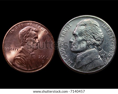 Penny and a Nickel over Black - stock photo