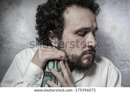 Penny-pinching, stingy businessman, saving money, man in white shirt with funny expressions - stock photo