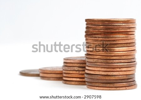 Penny stack graph, completely out of focus toward rear - stock photo