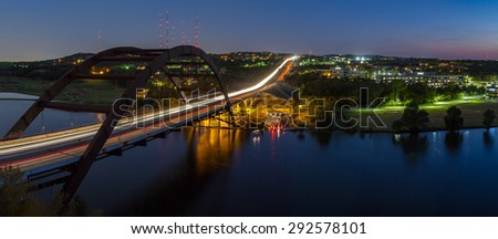 Pennybacker Bridge or the 360 Bridge at night across Lake Austin in Austin, Texas, United States. - stock photo