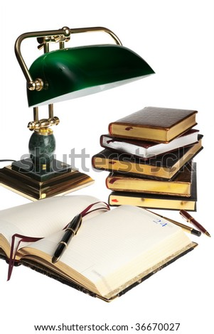 pens, books and a lamp on a white background - stock photo