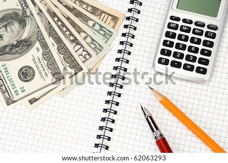 pens, pensil, calculator and dollars on pad - stock photo