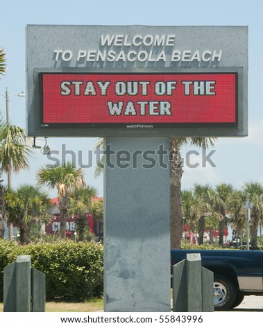 PENSACOLA BEACH - JUNE 23:  An electronic warning sign alerts beachgoers that the waters are closed on June 23, 2010 in Pensacola, FL. - stock photo