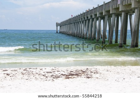 PENSACOLA BEACH - JUNE 23: Oil covered sand is shown near the pier area on June 23, 2010 in Pensacola Beach, FL. - stock photo