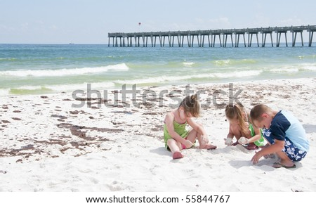 PENSACOLA BEACH - 23 JUNE: Unidentified young children play with sand near oil patches on June 23, 2010 in Pensacola Beach, FL. - stock photo