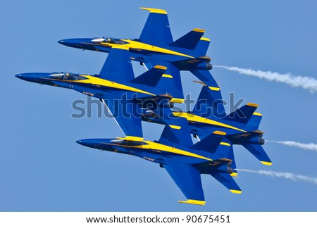 PENSACOLA, FL - NOVEMBER 11:US Navy Blue Angels in F-18 Hornet planes perform in air show routine in Pensacola, FL on November 11, 201. Blue Angels are the oldest active aerobatic team in the world - stock photo