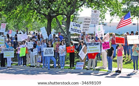 PENSACOLA, FLORIDA - APRIL 15: Protesters attend nationwide rally against increased government spending in Pensacola, Florida on tax day, April 15, 2009. - stock photo