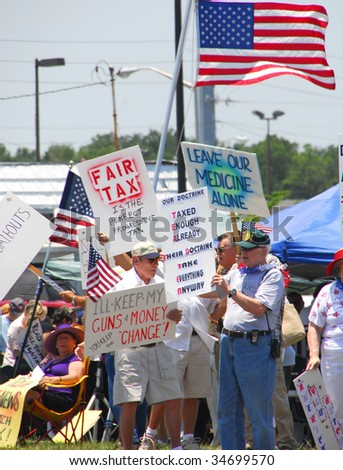 PENSACOLA, FLORIDA - JULY 4: Tea Party attendees gather as part of nationwide rallies to protest government spending and waste on July 4, 2009 in Pensacola, Florida. - stock photo