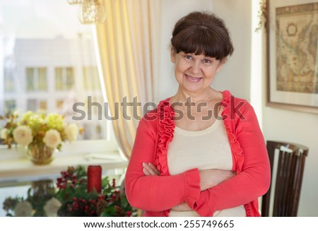 Pension age good looking woman portrait in domestic environment - stock photo
