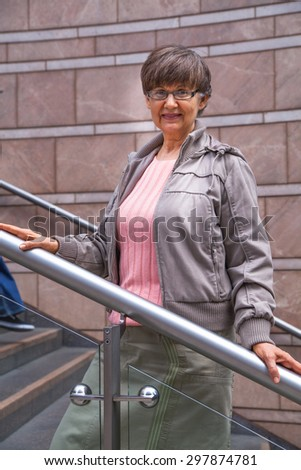 Pension age good looking woman portrait in the City - stock photo