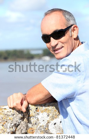 Pensioner on holiday - stock photo