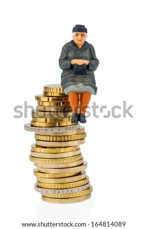 pensioner sitting on a pile of money, symbolic photo for pensions, retirement, old-age security - stock photo