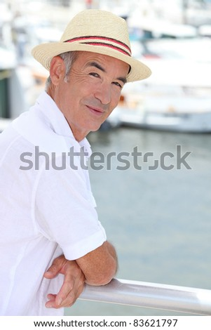 Pensioner stood by pork - stock photo