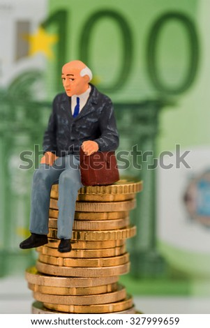 pensioners sitting on money stack, symbol photo for pension, retirement, pension - stock photo
