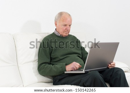 Pensioners  with notebook - stock photo