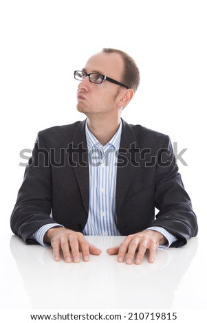 Pensive and doubtful isolated businessman looking at the side wearing suit. - stock photo