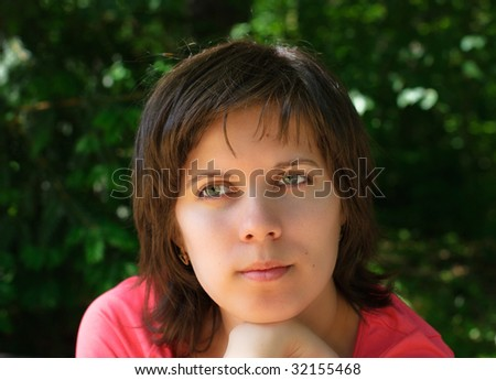 Pensive and dreaminess young girl - stock photo