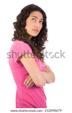 Pensive attractive brunette posing on white background