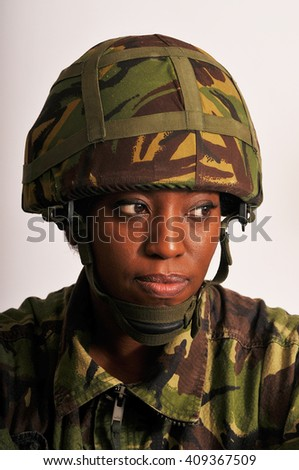 Pensive Black Female British Soldier - stock photo