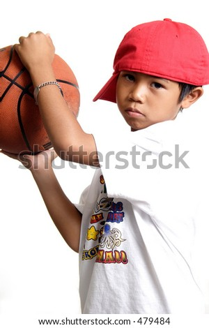 Pensive boy holding a basketball