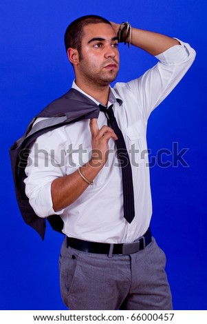 pensive business man portrait on blue background