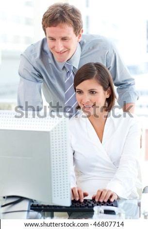 Pensive business people working at computers in the office - stock photo