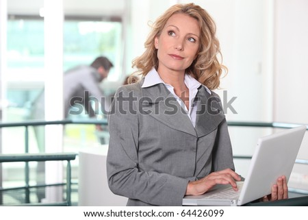 Pensive business woman in front of laptop